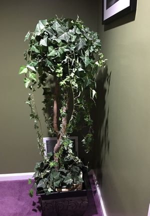 Artificial plant about 4ft tall with metal pot included for Sale in Gaithersburg, MD