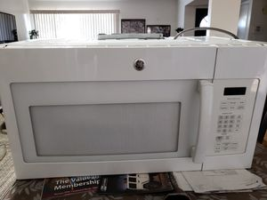 GE Over the top range Microwave for Sale in Bakersfield, CA