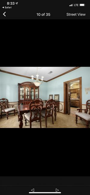 Wooden dining room table and chairs, armoire, and hutch for Sale in Houston, TX