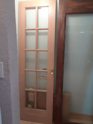Originally 1/2 of Sliding French Door, 24 x 79.5, plain wood, clear glass panels $50. Sturdy. For pick up. Sliding door brass handle No hinges for Sale in Miami, FL