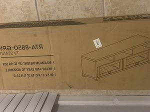 Grey Tv Stand up to 75 inch Tv brand new still in box will have to come and pick it up it's very heavy. for Sale in Homestead, FL