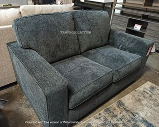 NEW, Slate Gray loveseat with Sporting Clean Lines and Sleek Track Arms. for Sale in Fountain Valley,  CA