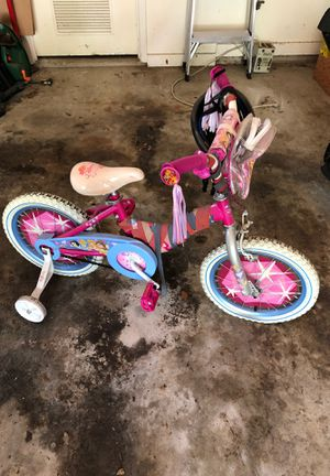 Girls bike with training wheels and helmet. for Sale in Austin, TX