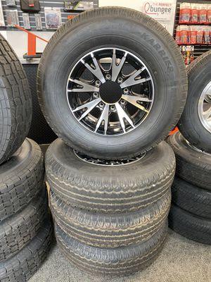 Set of (4) ST235/80R16 tires w/ 8 lug Aluminum wheels w/o center caps for Sale in Gresham, OR