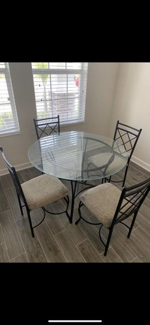 Glass kitchen table (not including the chairs) for Sale in Orlando, FL