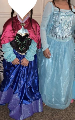 Elsa and Anna dresses sizes 12 in Elsa and 10 in Anna Walt Disney brand only worn once for Sale in Sacramento, CA