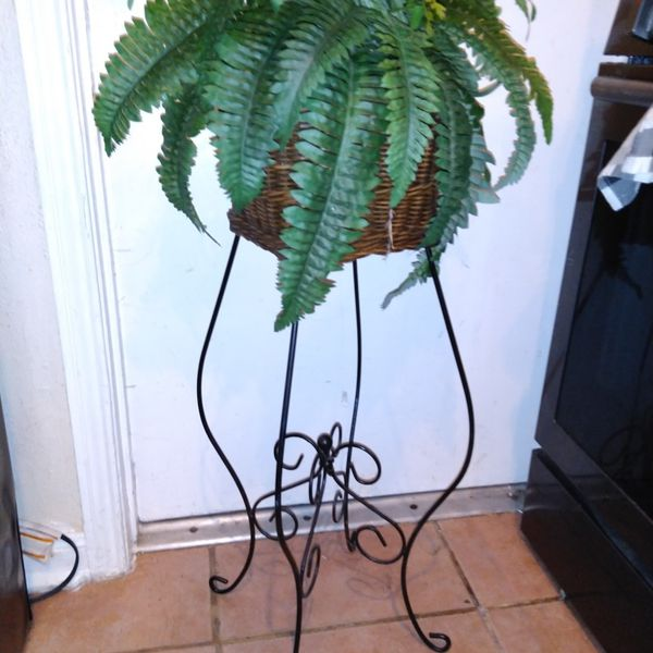Fake plant in basket on metal stand $15 40 inches tall x 16 round