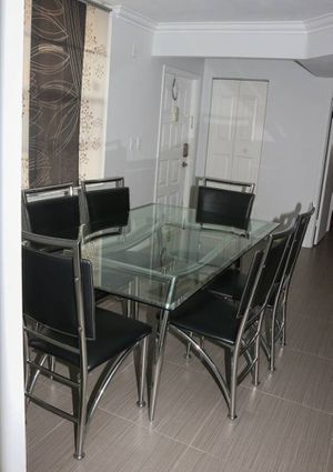 Modern Glass Dining room table with 6 black and chrome chairs for Sale in Pompano Beach, FL