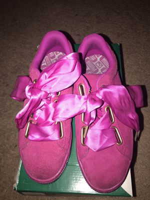 Gently used size 7 hot pink puma shoes with satin bow laces for Sale in Columbus, OH