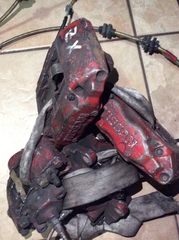 Z32 calipers front and rear. Nissan 240sx s14 big brake swap