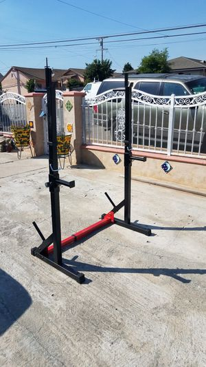 Adjustable width squat rack with dip bars, plate holders and safety catchers and for Sale in Montebello, CA