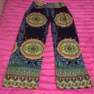"Women's size LARGE Gamiss colorful pants. WAIST:26"" LENGTH:34"" LEG OPENING:9"" for Sale in Saint Albans, WV"