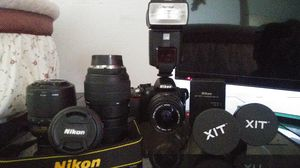 Nikon D3100 + 5 lenses, flash, 2 batteries and charger all in a bag for Sale in Houston, TX