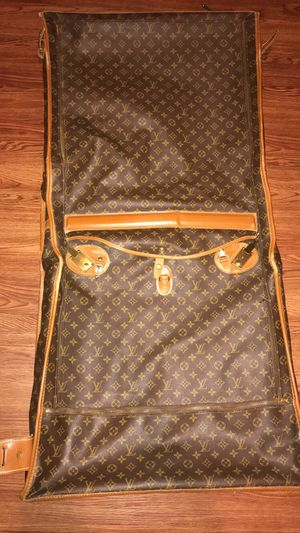 Louis Vuitton luggage fold over bag for Sale in Manor, TX
