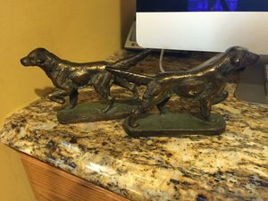 Dog bronze book ends $45 round oak chair $75 Art Deco clock $275 for Sale in Gibsonia, PA