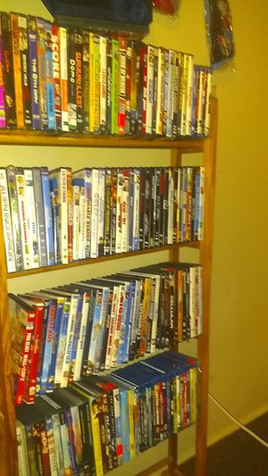 I have a movie stand 60 movies for Sale in Waterbury, CT
