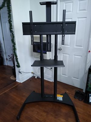 STAND TV. NB NORTH BAYOU, Floor stand tv mobile cart, **Looks like new** for Sale in Chicago, IL