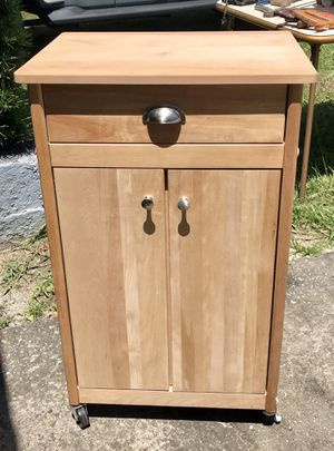Wood rolling kitchen table with butcher block top, top drawer and cabinet for Sale in Saint Petersburg, FL