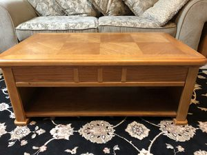 Set of three coffee table that elevates and two end tables for Sale in Houston, TX