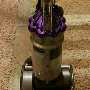 Dyson DC-17 Animal.... Old vacuum works but main tube isn't completely connected to the bottom of vacuum. All the main parts still work. for Sale in Maple Valley, WA