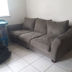 Plush 3 cushion dark green couch for Sale in Sarasota, FL