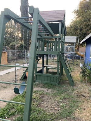 Big wooden swing set $400 cash only for Sale in Fresno, CA