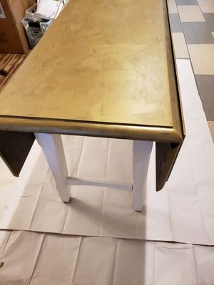Double Drop down table in Metalic Silver and Gold to look like metal. The Table looks GOLD in picture but not in person. Base is Vintage white for Sale in Byron, CA