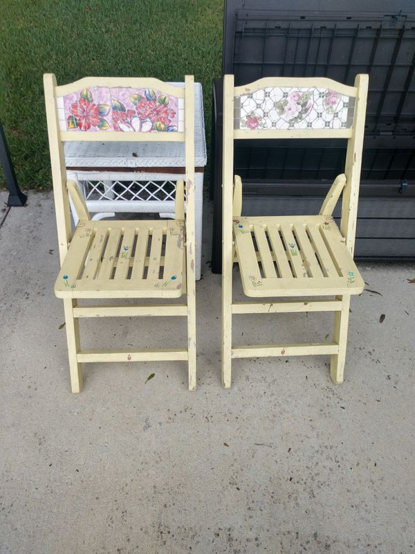 2 wooden foldable chairs