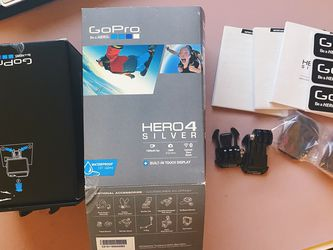 Gopro Hero 4 Silver Box And Few Accessories for Sale in Manassas,  VA
