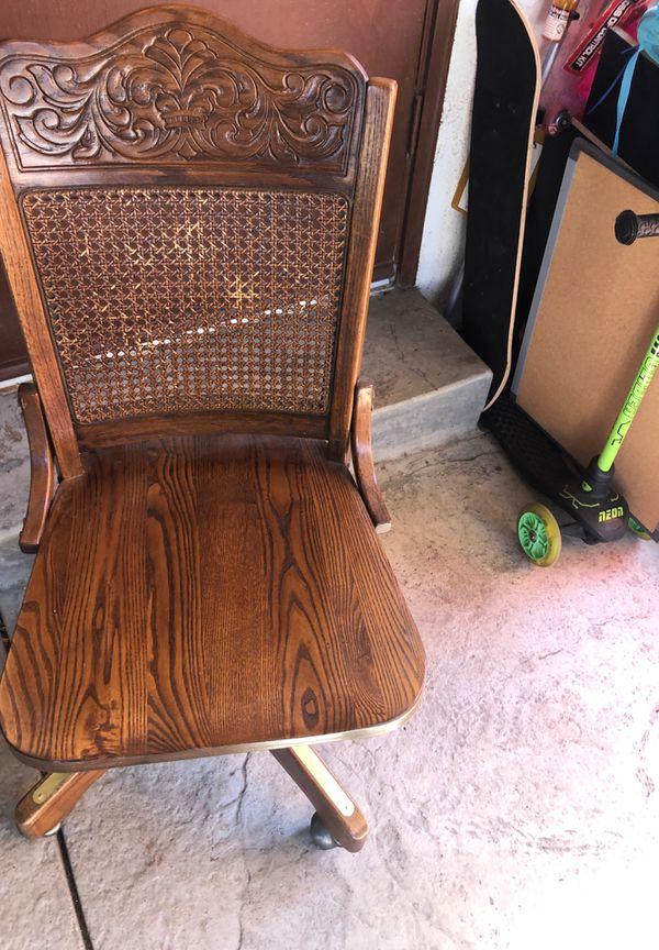 Wooden swiveling desk chair on wheels