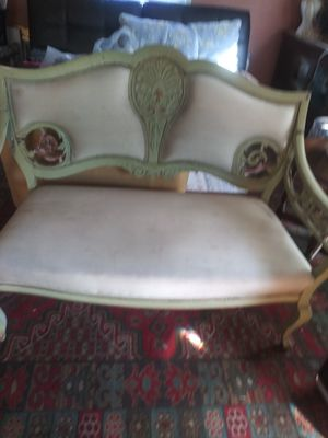 Antique sofa chair for repair is broken from the decoratio on the sides for Sale in Fullerton, CA