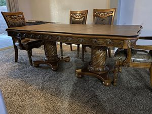 Dining room table with leaf extenders and covers *disassembled* for Sale in Las Vegas, NV