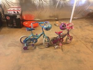 Two Girl Bikes with Helmets. Blue bike is frozen character and pink is princess for Sale in Jessup, MD