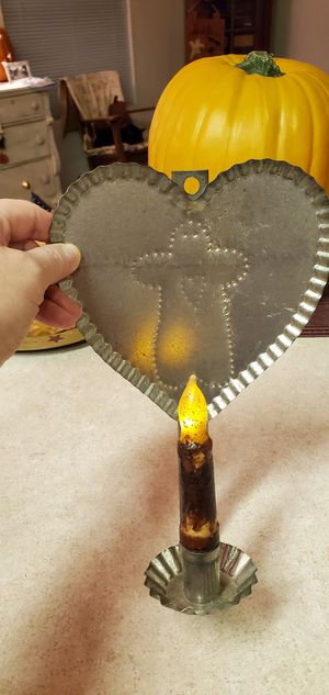 "Punched tin heart gingerbread candle holder and flicker candle. Approximately 10"" has some marks for Sale in Long Beach, CA"