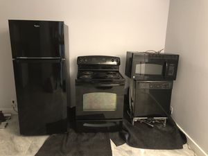 Set of appliances GE range, dishwasher, microwave and Whirlpool fridge located in Miami Beach for Sale in Hermosa Beach, CA