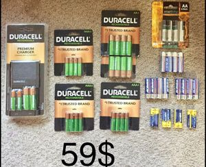 Premium charger with 24 rechargeable batteries and 32 regular batteries all brand new sealed for Sale in Silver Spring, MD