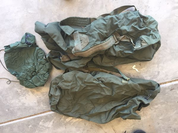 2 army duffle bags and 1 water proof bag