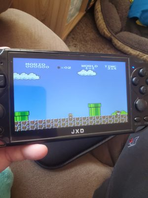 JXD handheld retro sell or open to trades for Sale in Millersville, MD