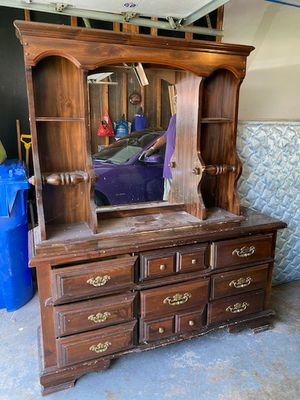 Dresser with mirror...only dusty been inside storage..but good news it free to anyone wants..must pickup. for Sale in Florissant, MO