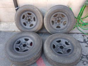 Set of four chevy or GMC 6 lug steel rims and tires 16 inch for Sale in Montebello, CA