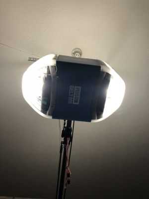 Cumberland garage door motor and track. With wall remote for Sale in Nashville, TN