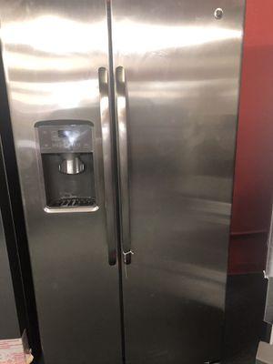 Used GE 27 cu ft stainless steel side by side fridge. 1 year warranty for Sale in St. Petersburg, FL