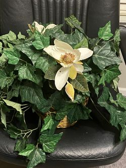 FAKE PLANTS AND FLOWERS IN A STURDY WICKER BASKET WILL LAST FOREVER AND NO MESS IN THE HOUSE for Sale in Schaumburg,  IL