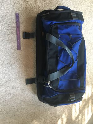Roller duffel convertible backpack suitcase for Sale in Houston, TX