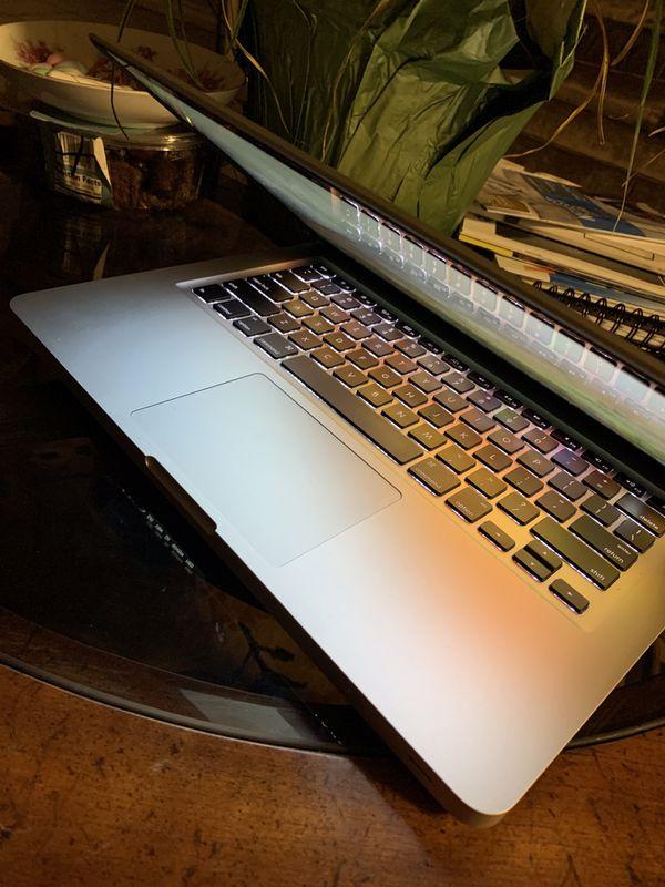 Apple MacBook Pro 13 Inches Core I5, Processor, 4 GB Ram, 500 GB Storage $350
