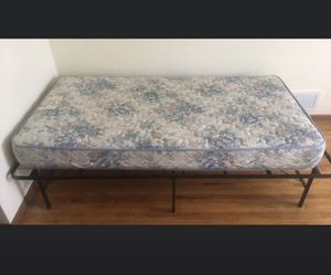 Twin mattress and metal frame for Sale in Burnsville, MN