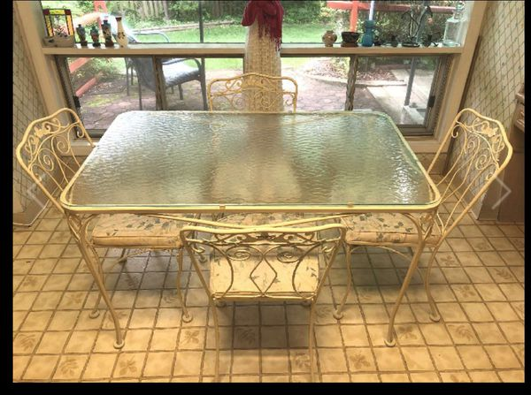 Wrought Iron patio table and 4 chairs and glass top