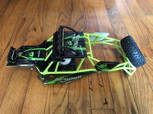 Wl toys outer shell skeleton with headlights and side plates for remote control car for Sale in Columbia, SC
