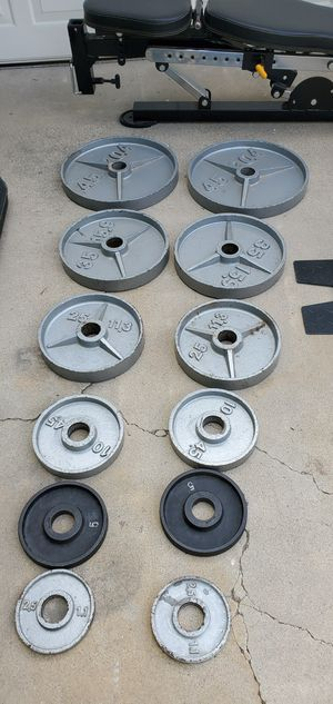 Near new 6 pairs of olympic weights and bench for Sale in Anaheim, CA