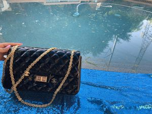 Black Chanel leather bag with red interior. for Sale in Gilbert, AZ